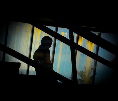 man stairs dark photo